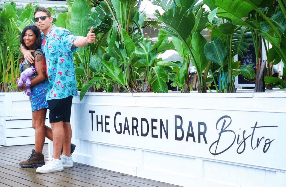 Couple hugging at The garden bar airlie beach